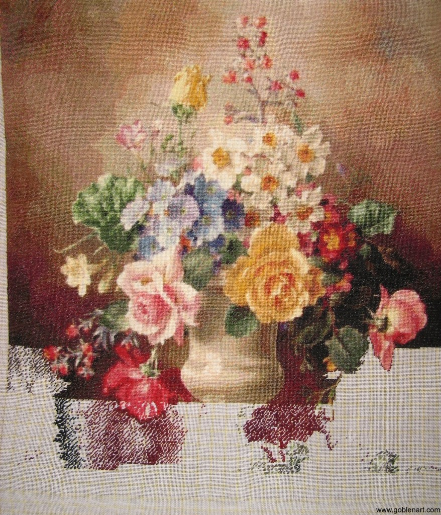 A still life study of roses, forget-me-nots and other flowers in an urn, resting on a stone ledge - sewing period