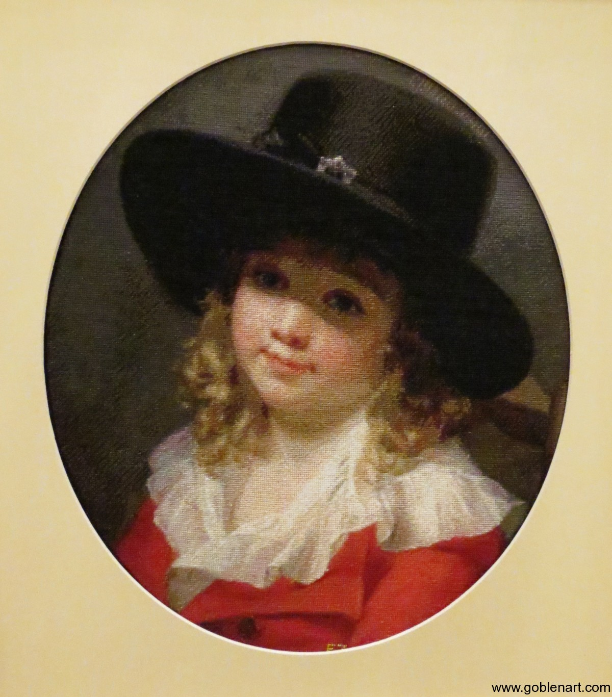 Portrait of a young boy wearing a black hat and red coat